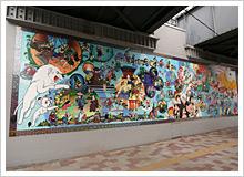 「堀部安兵衛の仇討ち」など過去の街並み、「手塚治虫の執筆風景」など昭和・現在の街並み、さらに未来の街並みを多彩なキャラクターで表現